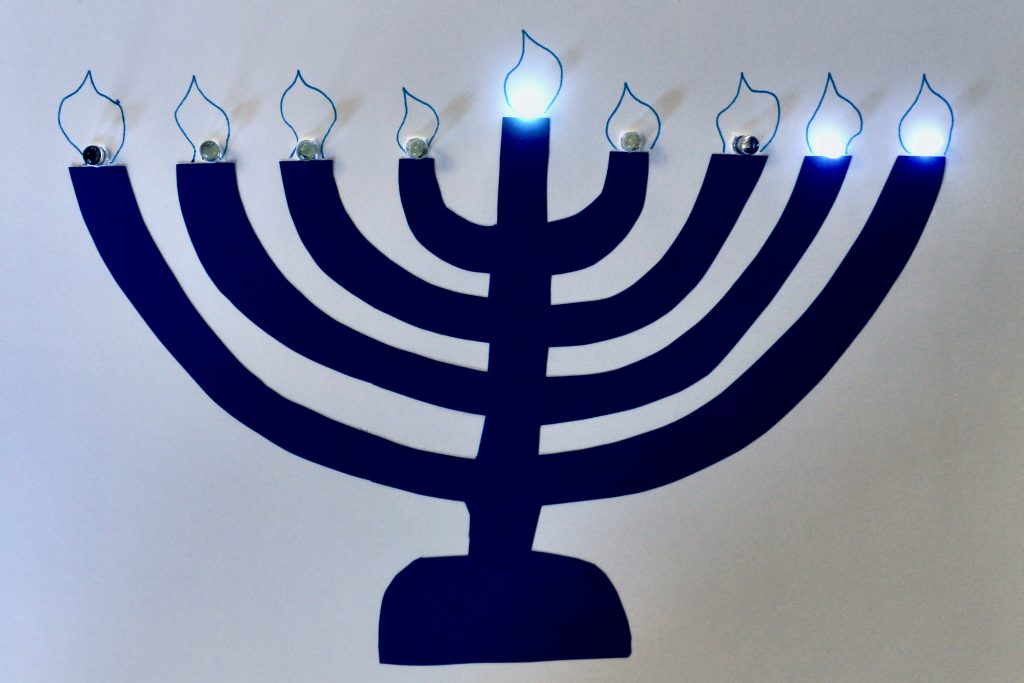 Menorah with shamash and two right candles lit.